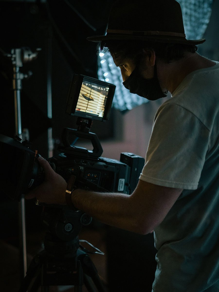 Director watching monitor on set