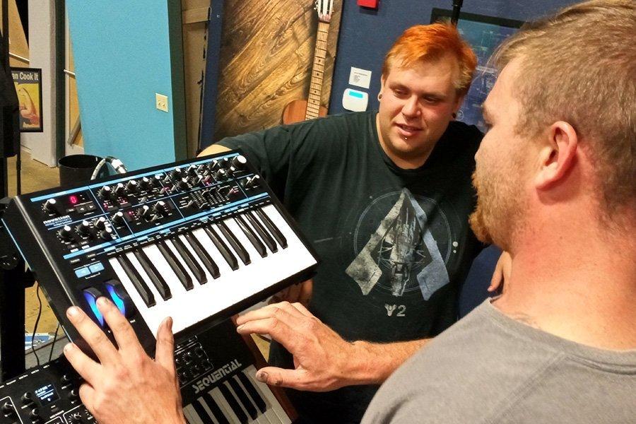 Staff Playing Keyboard