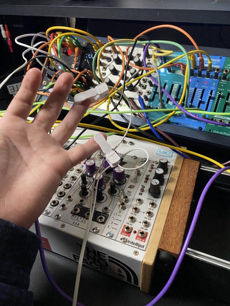 Testing biofeedback sensor on hand.